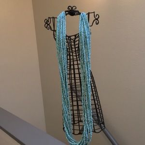 Jewelry - Long turquoise color beaded necklace.